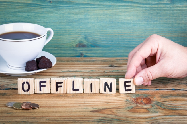 offline. Wooden letters on the office desk, informative and communication background